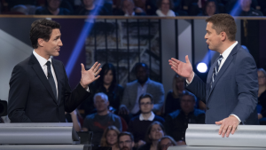 Conservative leader Andrew Scheer, right, and Liberal leader Justin Trudeau gesture to each other as they both respond during the Federal leaders debate in Gatineau, Que. on Monday, October 7, 2019. (THE CANADIAN PRESS/Justin Tang)