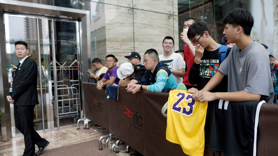 Chinese basketball fans gather outside of a hotel for a press conference that was later postponed ahead of an NBA preseason basketball game on Thursday between the Los Angeles Lakers and Brooklyn Nets in Shanghai, China, Wednesday, Oct. 9, 2019. (AP Photo)