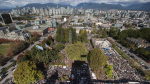 Thousands of people gather outside Vancouver City Hall before marching downtown during a climate strike in Vancouver on Friday, Sept. 27, 2019. (Darryl Dyck / THE CANADIAN PRESS)