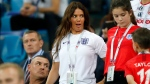 In this file photo dated Monday, June 18, 2018, Rebekah Vardy, wife of England's forward Jamie Vardy, reacts on the tribune during a 2018 soccer World Cup match between Tunisia and England in Volgograd, Russia. (AP Photo/Frank Augstein, FILE)