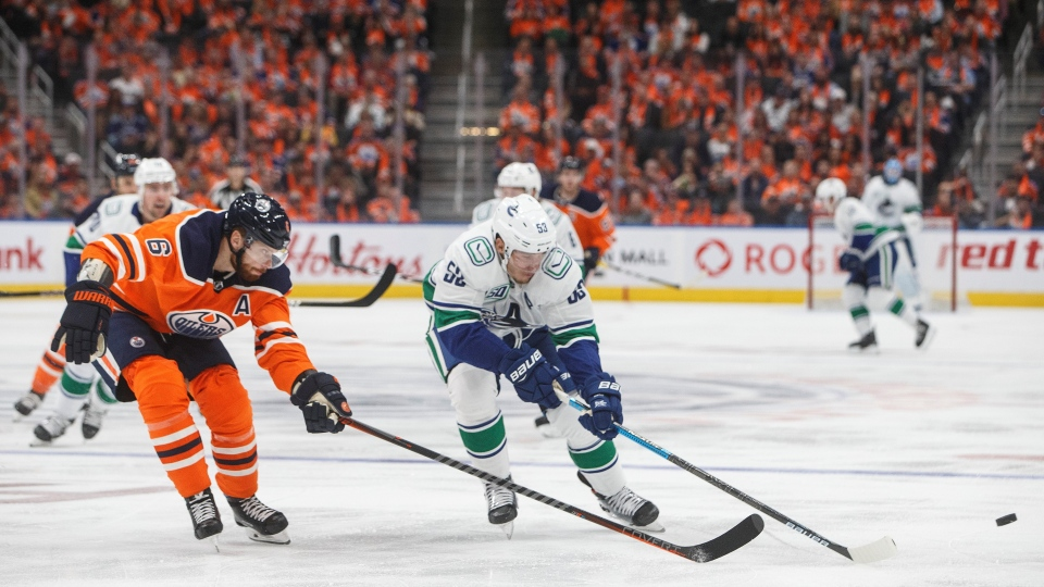 Vancouver Canucks ' Bo Horvat (53) is poke checked by Edmonton Oilers' Adam Larsson (6) during third period NHL action in Edmonton, Wednesday, Oct. 2, 2019. THE CANADIAN PRESS/Jason Franson