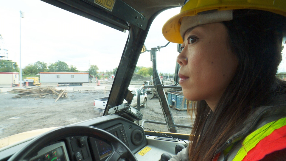 Canadian immigrant Shengnan Li is helping make inroads for the rebuilding of Quebec's largest interchange by operating an articulated dump truck. (CTV)
