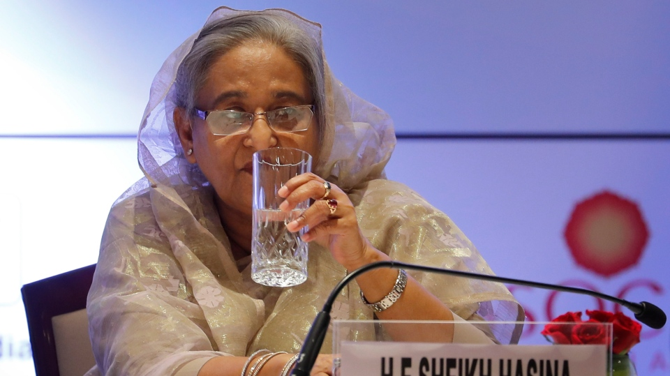 Bangladeshi Prime Minister Sheikh Hasina drinks water before speaking at the business forum meeting in New Delhi, India, Friday, Oct. 4, 2019. Hasina arrived in India on Thursday for a visit during which she is expected to sign agreements on increasing trade and investment and improving regional connectivity. (AP Photo/Manish Swarup)