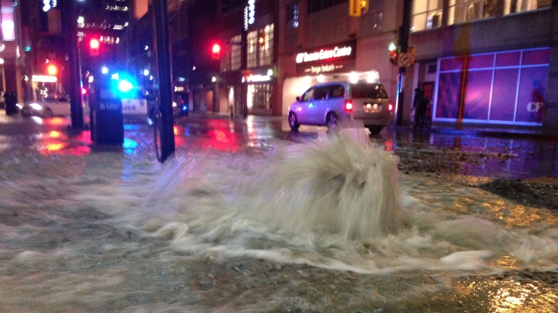Police working to repair a water main break on Yonge Street near the Eaton Centre. (Cam Woolley/ CP24)