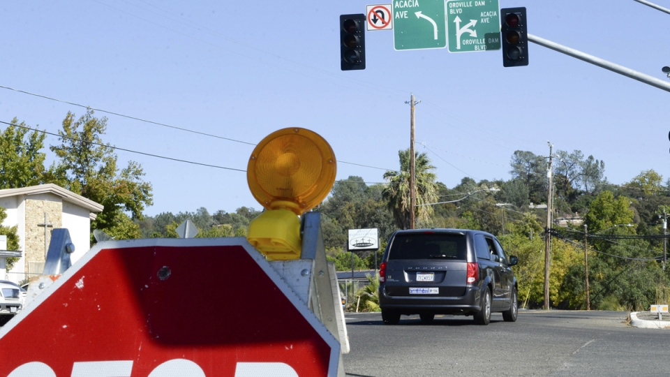 A stop sign is placed at an Oroville Dam Boulevard intersection with no power, on Oct. 9, 2019, in Oroville, Calif. (Matt Bates / Chico Enterprise-Record via AP)