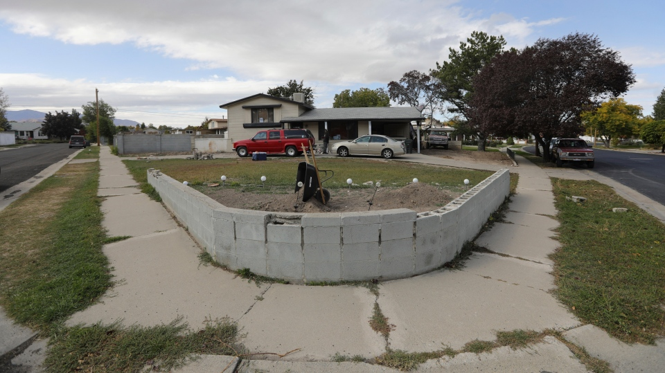 A Utah home that was owned by an Arizona elected official charged with human smuggling in an adoption fraud scheme is shown Wednesday, Oct. 9, 2019, in West Valley City, Utah. (AP Photo/Rick Bowmer)