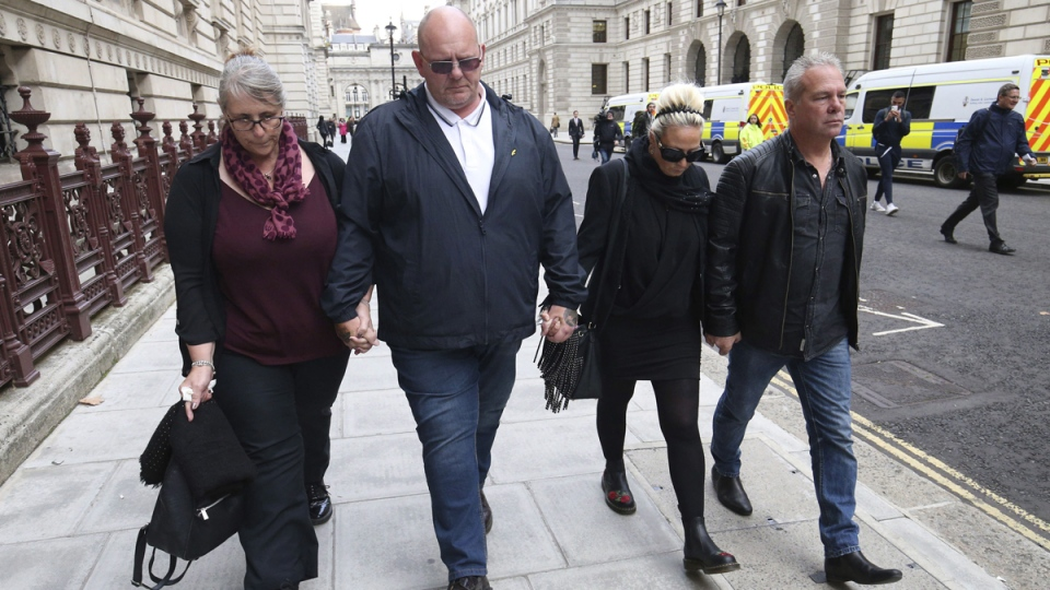 The family of Harry Dunn, mother Charlotte Charles, second right, and father Tim Dunn, second left, arrive with their partners at the Foreign and Commonwealth Office in London, on Oct. 9, 2019. (Jonathan Brady / PA via AP)
