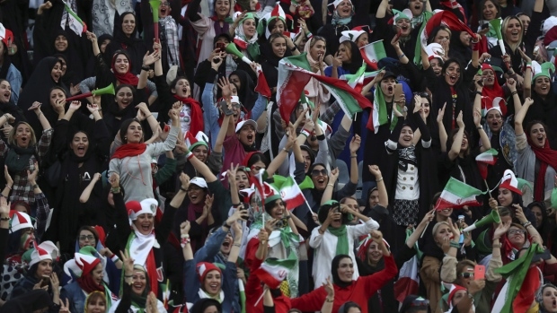 Iranian women cheer at the Azadi Stadium in Tehran