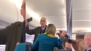 A flight from London to Dublin was delayed due to a climate change protester refusing to sit down.