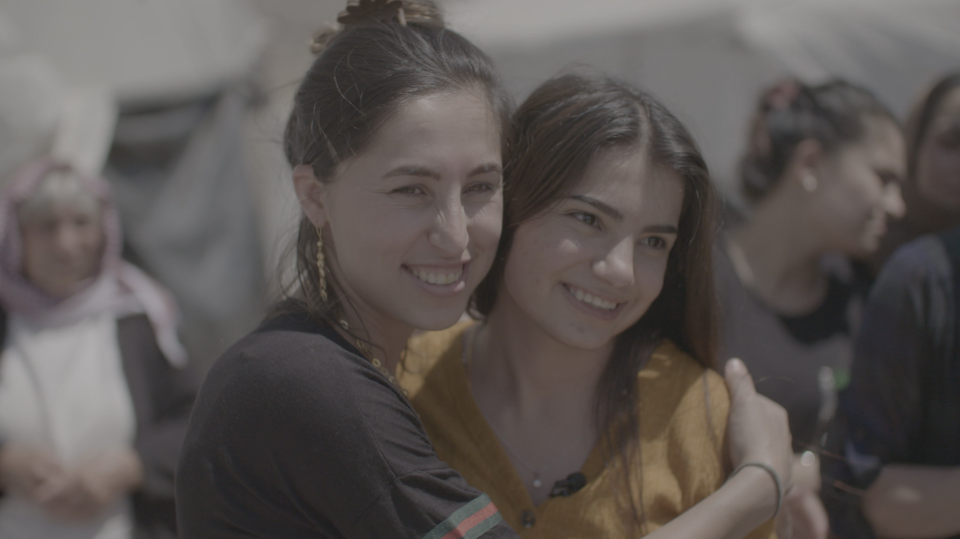 Dalal, left and Dilveen, right, reunite in northern Iraq, five years after they were torn apart at an ISIS slave market.