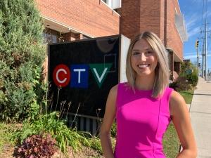 Shannon Bradbury poses in front of CTV Kitchener