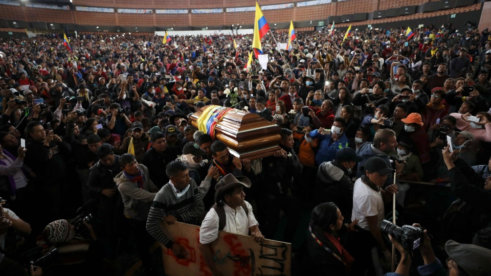 Anti-government protesters carry a coffin that contain the remains of a companion who they say died during yesterday's national strike, in Quito, Ecuador, Thursday, Oct. 10, 2019. (AP Photo/Fernando Vergara)