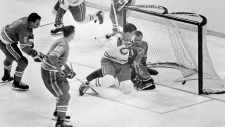May 7, 1968, file photo, Montreal Canadiens' Serge Savard is about to land in the lap of St. Louis Blues' goalie Glenn Hall as the puck spins into the net for the winning goal in the NHL Stanley Cup finals at St. Louis, Mo. The Blues made the Stanley Cup Finals in their first three seasons but lost in sweeps to the Montreal Canadiens in 1968 and 1969 and the Bruins in 1970. (AP Photo/File)