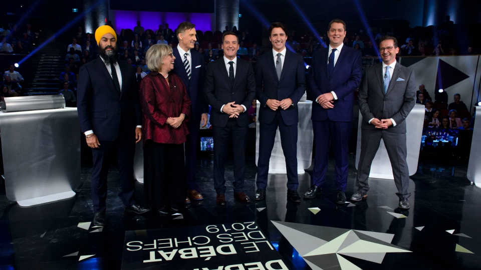 Host Patrice Roy from Radio-Canada, centre, introduces Federal party leaders, left to right, NDP leader Jagmeet Singh, Green Party leader Elizabeth May, People's Party of Canada leader Maxime Bernier, Liberal leader Justin Trudeau, Conservative leader Andrew Scheer, and Bloc Quebecois leader Yves-Francois Blanchet before the Federal leaders French language debate in Gatineau, Que. on Thursday, October 10, 2019. THE CANADIAN PRESS/Sean Kilpatrick