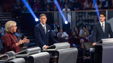 Green Party Leader Elizabeth May, left to right, People's Party of Canada Leader Maxime Bernier, and Liberal Leader Justin Trudeau takes part in the French-language debate in Gatineau, Que. on Thursday, October 10, 2019. THE CANADIAN PRESS/Adrian Wyd