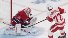 Detroit Red Wings' Andreas Athanasiou shoots on Montreal Canadiens goaltender Carey Price during second period NHL hockey action in Montreal, Thursday, October 10, 2019. THE CANADIAN PRESS/Graham Hughes