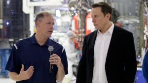 NASA Administrator Jim Bridenstine, left, talks with SpaceX chief engineer Elon Musk about the progress to fly astronauts to and from the International Space Station, from American soil, as part of the agency's commercial crew program at SpaceX headquarters, in Hawthorne, Calif., Thursday, Oct. 10, 2019. (AP Photo/Alex Gallardo)