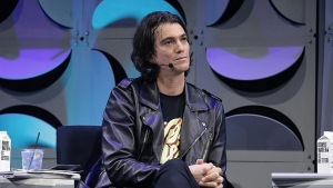Adam Neumann, pictured in January 2018, announced last month that he was stepping down as chief executive of WeWork. (AFP)