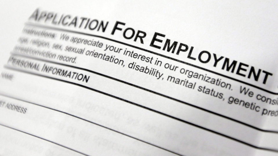 This April 22, 2014 file photo shows an employment application form. (Mike Groll / AP)
