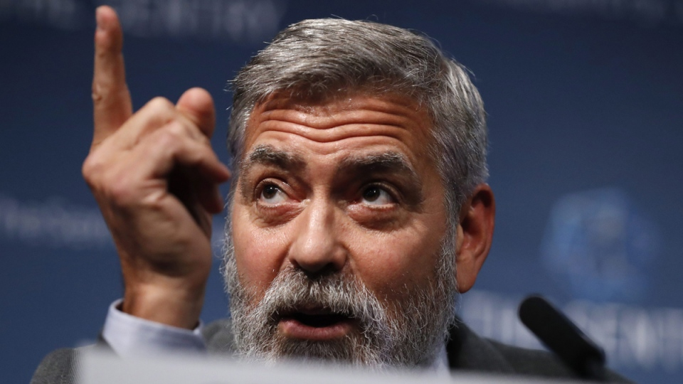George Clooney speaks at a press conference in London, on Sept. 19, 2019. (Alastair Grant / AP)