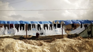 Laundry dries on a chain-link fence at Al-Hol camp in Hassakeh province, Syria, on March 31, 2019. (Maya Alleruzzo / AP)