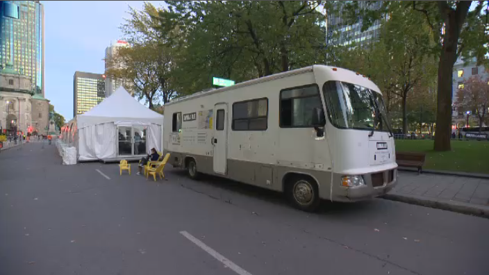 About 60 professionals slept in tents in downtown Montreal Thursday night to raise funds for Dans La Rue