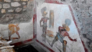 A view of a well-preserved fresco depicting fighting gladiators in the ancient Roman city of Pompeii, Italy, recently unearthed by archeologists. The new discovery -- located in the Regio V site, north of the archaeological park -- was unveiled on Friday and it's not open to the public yet. (Archeological Park of Pompeii via AP)