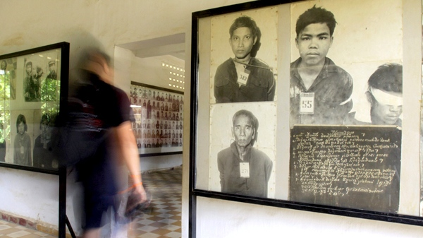 A tourist walks through the Tuol Sleng genocide museum, formerly the Khmer Rouge's notorious S-21 prison, in Phnom Penh, Cambodia, on Wednesday, Aug. 12, 2009. (AP / Heng Sinith)