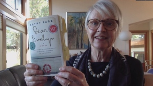 Novelist Kathy Page holds up her award-winning novel, Dear Evelyn: Oct. 11, 2019 (CTV News)