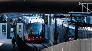 LRT trains on OC Transpo's new O-Train Confederation Line stop at Lees Station in Ottawa, on Friday, Oct. 11, 2019. THE CANADIAN PRESS/Justin Tang