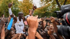 Eliud Kipchoge celebrates after breaking the historic two hour barrier for a marathon in Vienna, Saturday, Oct. 12, 2019. (Thomas Lovelock/The INEOS 1:59 Challenge via AP)