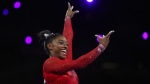 Gold medalist Simone Biles of the United States performs on the vault in the women's apparatus finals at the Gymnastics World Championships in Stuttgart, Germany, Saturday, Oct. 12, 2019. (AP Photo/Matthias Schrader)