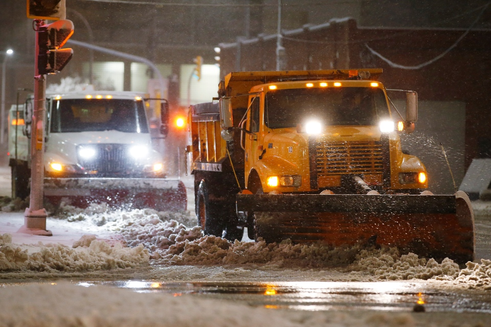 Crews cleanup during an early winter storm with heavy wet snow which caused caused fallen trees, many on cars, and power lines in Winnipeg early Friday morning, October 11, 2019. Snow clearing crews were forced to hit the streets to clean up the damage. THE CANADIAN PRESS/John Woods