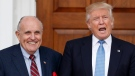 In this Nov. 20, 2016, file photo, then-President-elect Donald Trump calls out to media as he and former New York Mayor Rudy Giuliani pose for photographs as Giuliani arrives at the Trump National Golf Club Bedminster clubhouse in Bedminster, N.J.  (AP Photo/Carolyn Kaster, File)