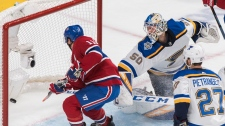 St. Louis Blues goaltender Jordan Binnington is scored on by Montreal Canadiens' Tomas Tatar, not shown, as Canadiens' Brendan Gallagher (11) and Blues' Alex Pietrangelo look for a rebound during first period NHL hockey action in Montreal, Saturday, Oct. 12, 2019. THE CANADIAN PRESS/Graham Hughes