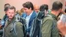 High profile security surrounds Liberal Leader Justin Trudeau as he arrives at a rally in Mississauga, Ont., Saturday, Oct. 12, 2019. The Rally was delayed for 90 minutes due to a security issue. THE CANADIAN PRESS/Frank Gunn