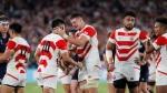 Japan's Luke Thompson, center right, celebrates with teammates after winning over Scotland in the Rugby World Cup Pool A game at International Stadium in Yokohama, Japan, Sunday, Oct. 13, 2019. (AP Photo/Eugene Hoshiko)