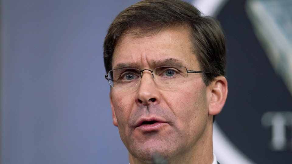 "In this Aug. 28, 2019, file photo, Secretary of Defense Mark Esper speaks to reporters during a briefing at the Pentagon. Esper says the ""impulsive"" decision by Turkey to invade northern Syria will further destabilize a region already caught up in civil war.  (AP Photo/Manuel Balce Ceneta, File)"