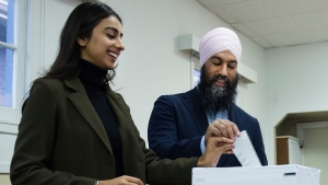 NDP leader Jagmeet Singh, right, and his wife Gurkiran Kaur, left, cast their ballets at an advanced polling station in his Burnaby South riding during a campaign stop in Burnaby, B.C., on Sunday, October 13, 2019. THE CANADIAN PRESS/Nathan Denette