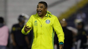 Coach Roger Machado of Brazil's Palmeiras, gives directions to his players during a Copa Libertadores soccer match against Peru's Alianza Lima, in Lima, Peru, Thursday, May 3, 2018. (AP Photo/Martin Mejia)