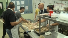 Volunteers carved thirty turkeys for 800 guests