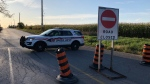 Emergency crews block off a road due to a collision that left two people dead and one injured. (Carol Charles/CTV News Toronto)