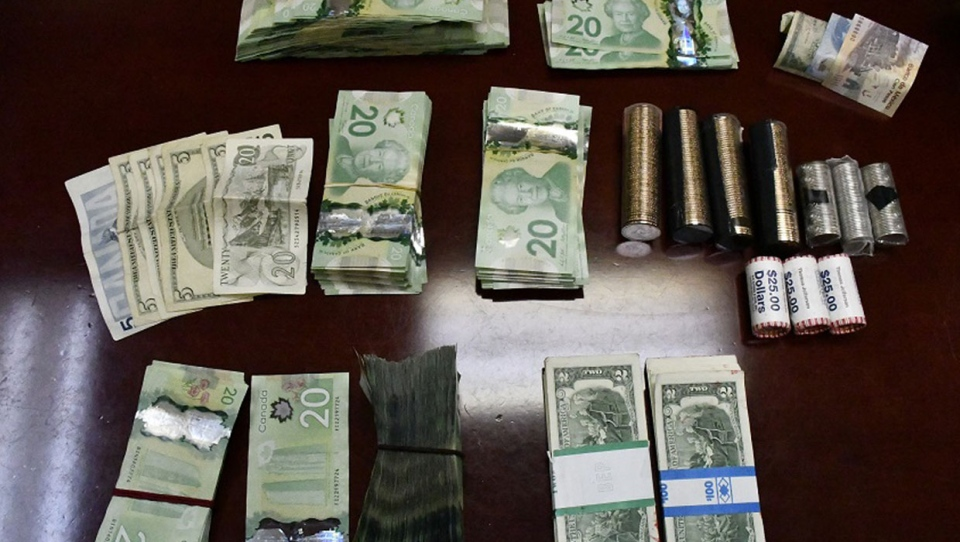 The suspects were found in possession of a large quantity of cash, including a number of bills that are out of circulation, (Supplied)