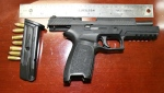 One of the suspects was found in possession of a loaded pistol when he was arrested by RCMP in Drumheller. (Supplied)