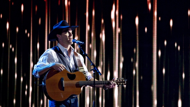 George Canyon performs during the Canadian Country Music Awards in Edmonton, Alberta on September 8, 2013. Country music star George Canyon is a rookie Tory candidate campaigning for votes in rural Nova Scotia and hoping to unseat the Liberal incumbent. THE CANADIAN PRESS/Jason Franson