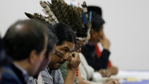 Indigenous leaders attend negotiations with President Lenin Moreno in Quito, Ecuador, Sunday, Oct. 13, 2019. (AP Photo/Fernando Vergara)
