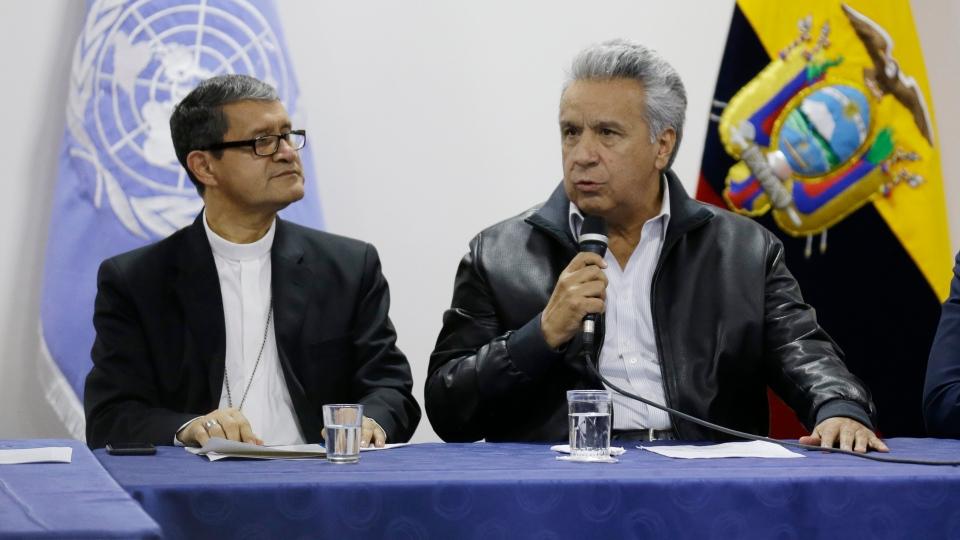Ecuadorian President Lenin Moreno speaks during negotiations with anti-government protesters in Quito, Ecuador, Sunday, Oct. 13, 2019. (AP Photo/Fernando Vergara)
