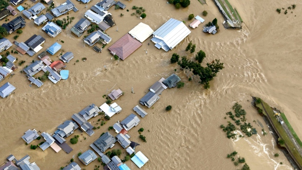 Residential area is seen in muddy waters after an embankment of the Chikuma River broke because of Typhoon Hagibis, in Nagano, central Japan, Sunday, Oct. 13, 2019. (Yohei Kanasashi/Kyodo News via AP)