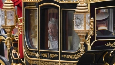 Queen Elizabeth II in a carriage to parliament