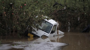 A small pickup truck is submerged in floodwaters at an apple orchard, on Oct. 14, 2019, in Hoyasu, Japan. (Jae C. Hong / AP)